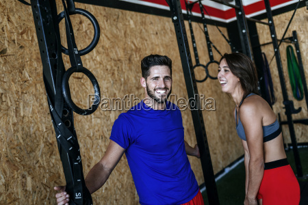 happy man and woman in gym