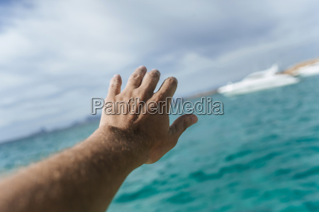 hand reaching out for distant motor
