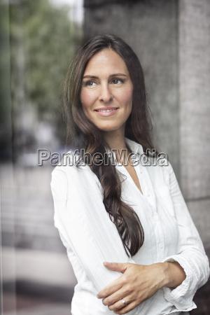portrait of confident businesswoman looking out