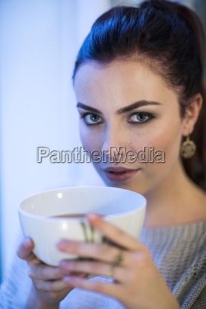 portrait of young woman with tea