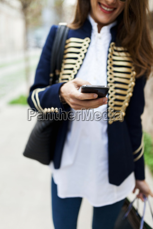 fashionable young woman using cell phone