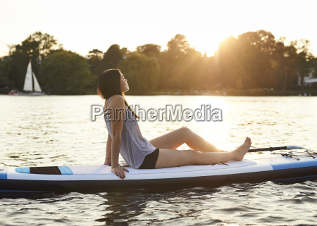 germany hamburg young woman on paddleboard