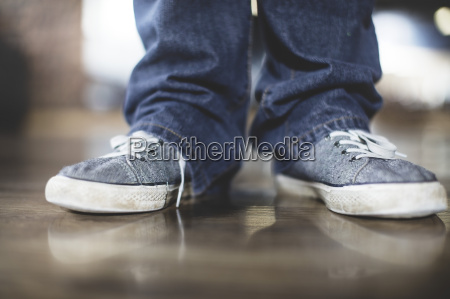 close up of man in sneakers