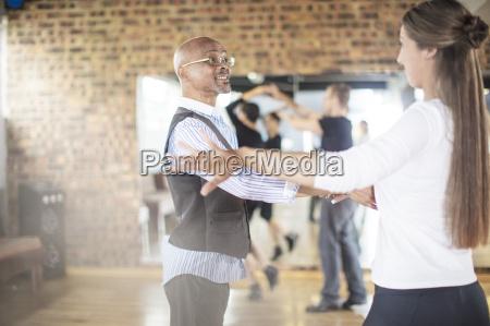 dance instructor teaching class in studio