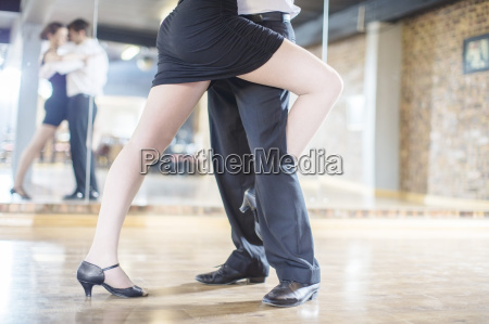 close up of couple dancing salsa