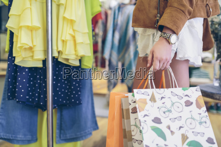 close up of woman holding shopping