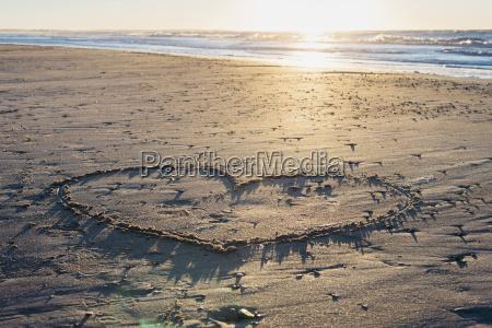 denmark blokhus heart drawn in sand