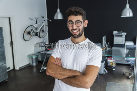 portrait ofsmiling man with glasses in