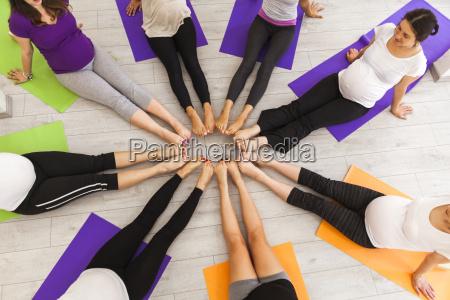 women in prenatal yoga class sitting