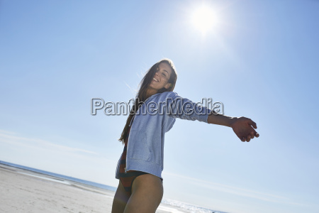 happy young woman with outstretched arms