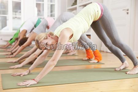 group of people in yoga studio