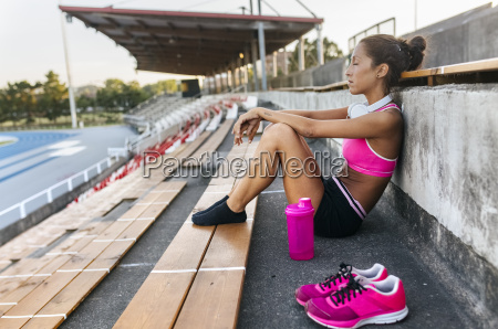 female athlete taking a break sitting