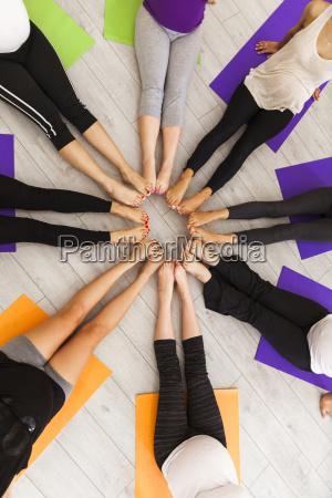 legs of women in prenatal yoga
