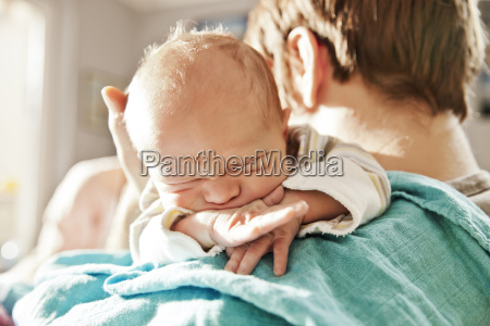 close up of father holding his