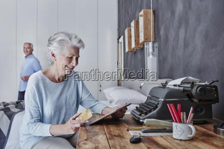 smiling senior woman shopping online in
