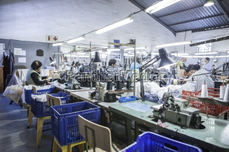seamstresses in factory sewing clothes