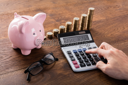 person calculating savings on calculator