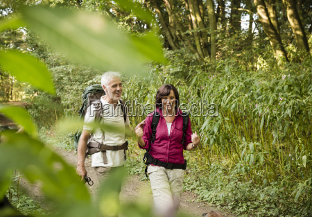 senior couple hiking on a trail