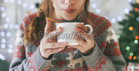 woman with cup of coffee at