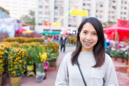 woman go chinese flower market in