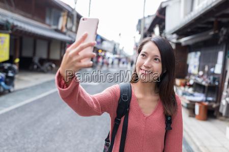 woman taking photo in kurokabe square