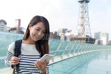 woman reading on cellphone in nagoya