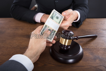 businessman giving a bribe to a