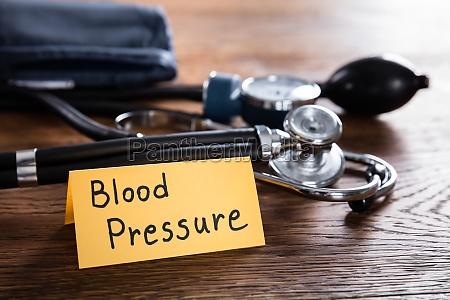 blood pressure concept on wooden desk