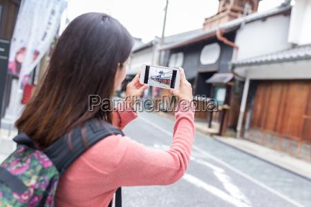 woman taking photo in nagahama city