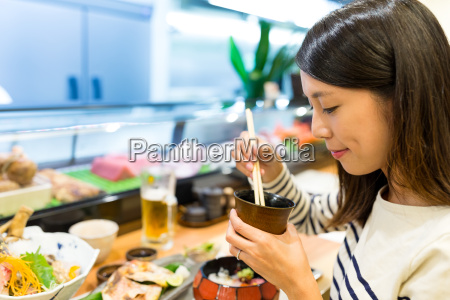 woman enjoy her soup in japanese