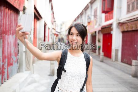 woman taking selfie by digital camera