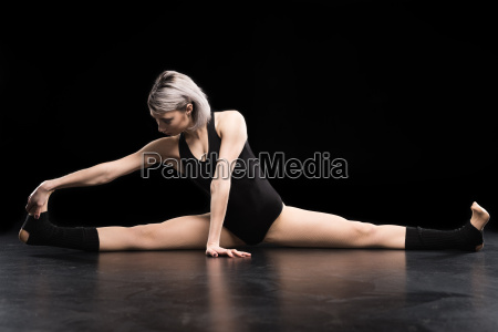attractive young athletic woman dancer stretching
