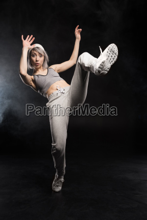 woman in sports clothing dancing on