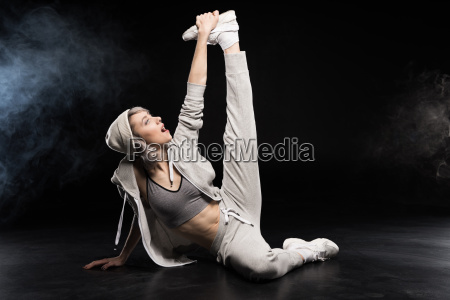 woman in sports clothing stretching on
