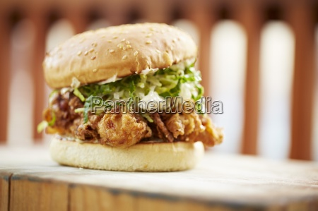 a burger with fried oysters next