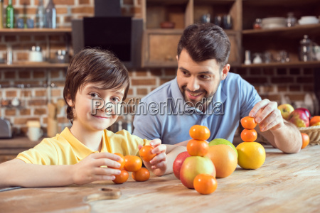 happy father and son playing with