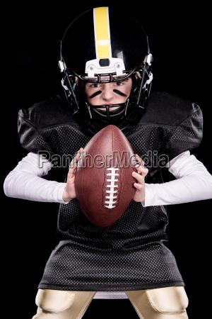 aggressive little boy in protective sportswear