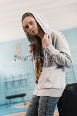 young sporty woman leaning at pommel