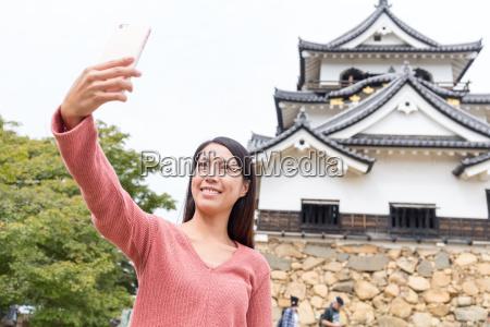 woman taking selfie in hikone castle