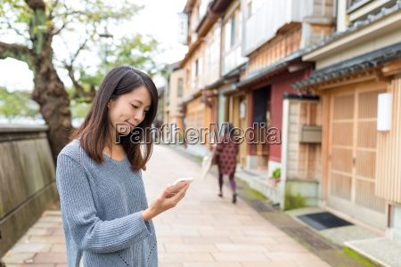 woman using cellphone in japanese old