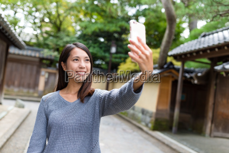 woman taking selfie by smart phone
