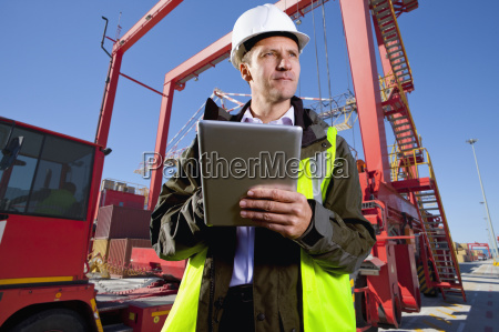 worker with digital tablet loading of