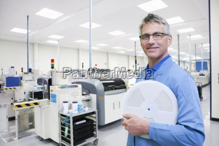 technician on factory floor of electronics