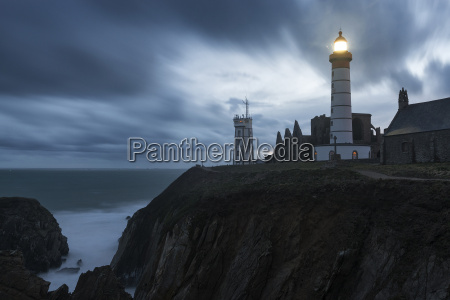 the st mathieu lighthouse illuminated at