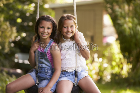 portrait of two girls playing on