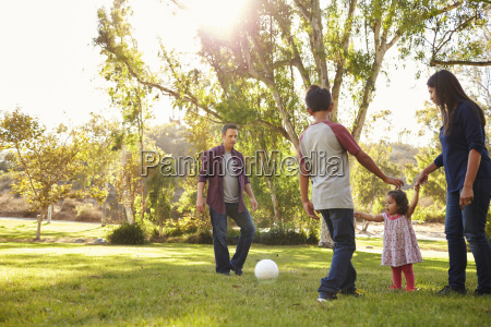 young mixed race family playing with