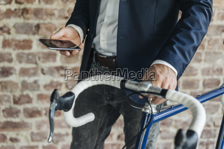 close up of businessman with bicycle