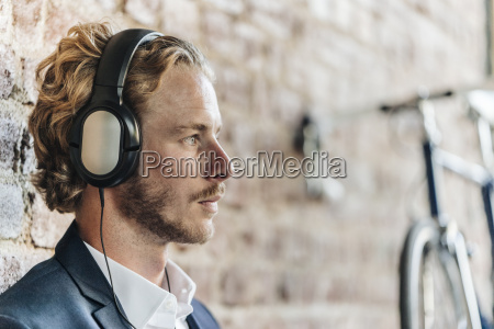 businessman wearing headphones