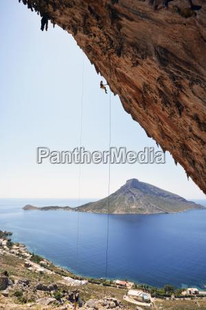 greece kalymnos climber abseiling in rock