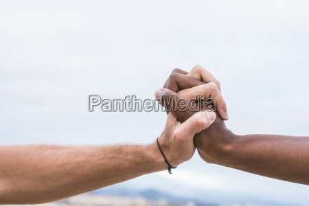 close up of two hands connected
